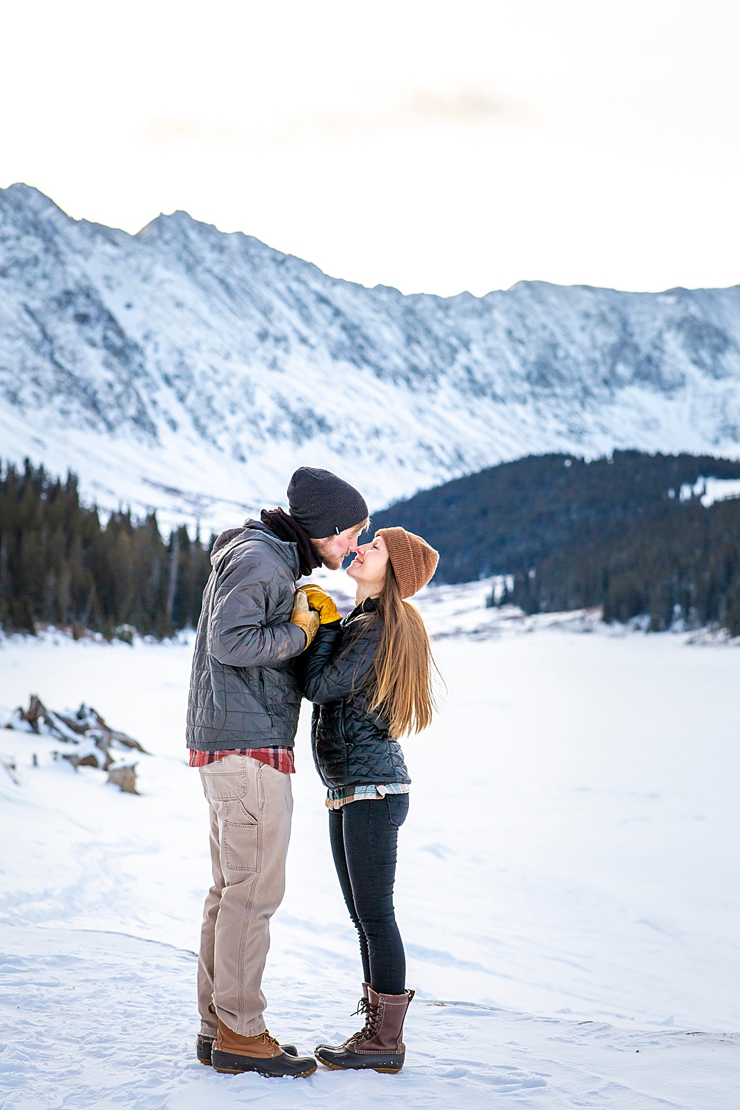 Engaged couple kisses in Breckenridge, Colorado. Photo taken by Hillary Shedd Photographer, Colorado Wedding Photographer.