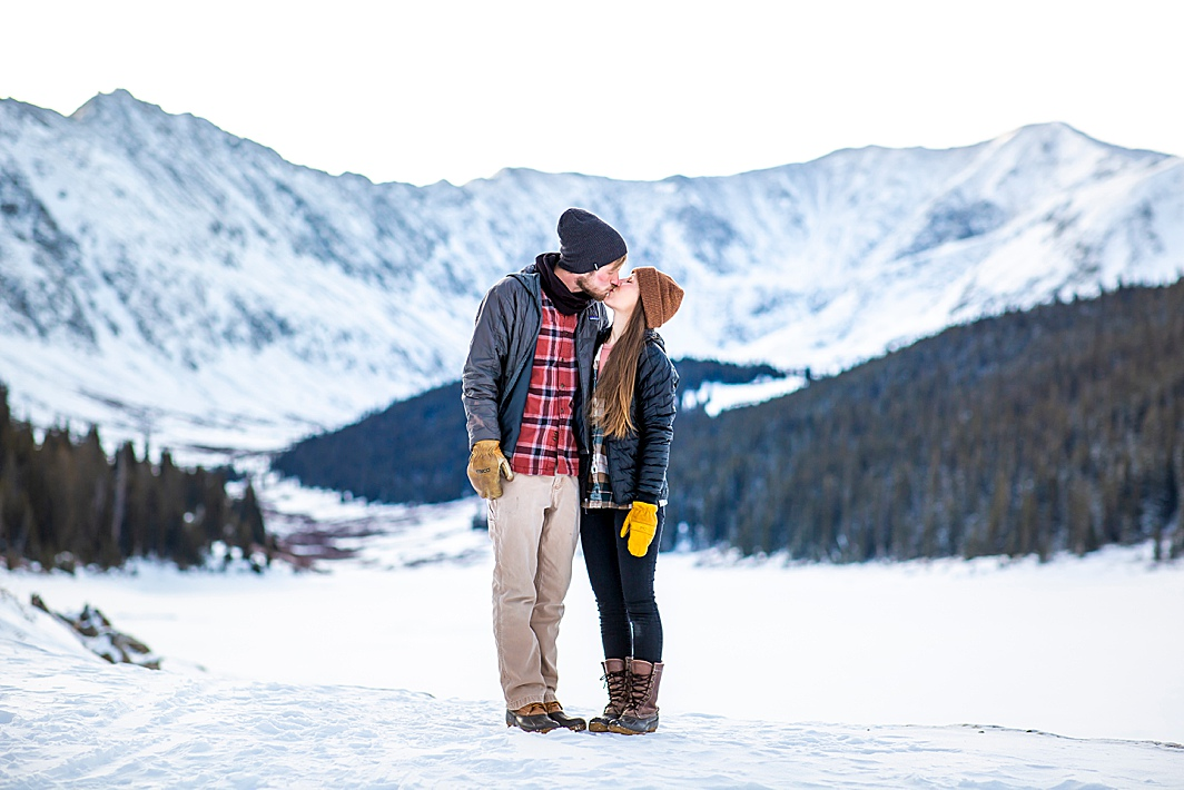 Engaged couple kisses in Breckenridge, Colorado by Colorado Wedding Photographer Hillary Shedd Photography