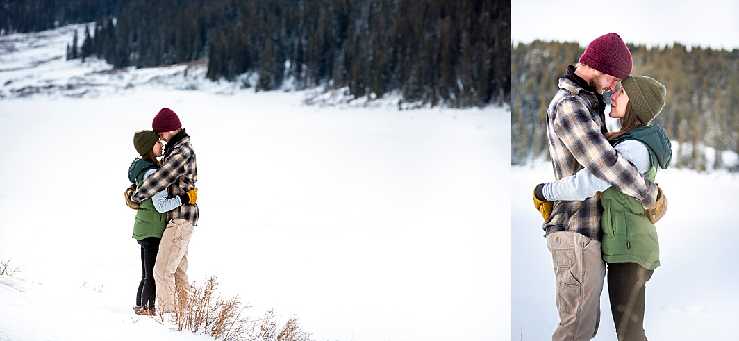 Couple embraces during their cute winter engagement session in Colorado with Hillary Shedd Photography.