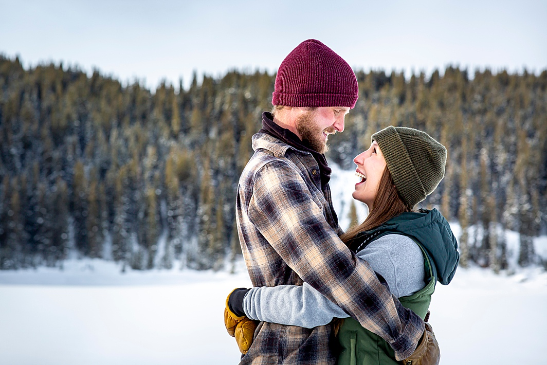 Love this! Cute couple gives loving expressions during their engagement photography shoot with Hillary Shedd Photography in Breckenridge, Colorado.