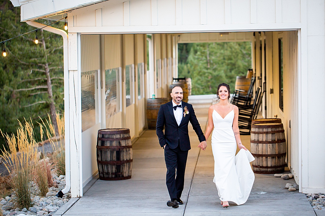 Couple walks while holding hands at a wedding in Colorado photographed by Hillary Shedd Photography, Colorado Wedding Photographer